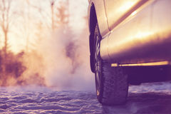 Car and powerful exhaust fumes in the air in Finland. Car and powerful exhaust fumes in the air. The sun reflects light from the side of the car in the winter royalty free stock photo