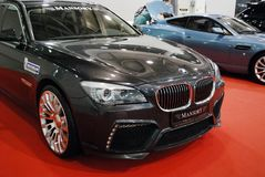 The car of a premium class of BMW 7er F01/F02 with tuning from Mansory at an exhibition in `Crocus Expo`, 2012. Moscow Royalty Free Stock Photo