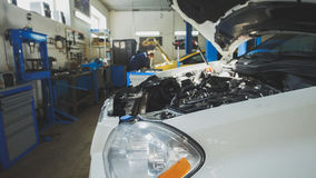 Car preparing for repairing - garage mechanical workshop, small business. Wide angle stock photos
