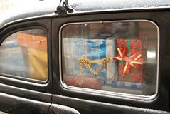 Car with presents. Window of car with lot of presents boxes Royalty Free Stock Image