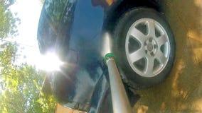 Car Pressure Jet Washing POV Stock Images
