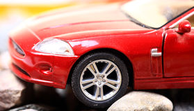 Car problem. Car stucked in rocky surface Royalty Free Stock Photos