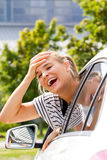 Car problem. Young woman having a problem with her car Royalty Free Stock Photography