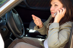 Car problem #5. Attractive woman with mobile phone Royalty Free Stock Image