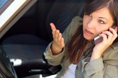 Car problem #5. Attractive woman with mobile phone Stock Photo