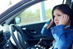 Car problem. Angry woman with mobile phone in her car Royalty Free Stock Photo