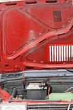 Car problem detail. Vintage car with open hood close up Stock Photography
