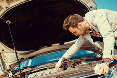 Car problem. Men having problem with car.Waiting for insurance assistance Royalty Free Stock Photos