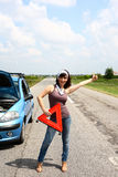 Car problem. Pretty girl with car problem on the road Royalty Free Stock Images