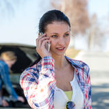 Car problem woman call road help. Broken car young women call road help need of assistance Stock Image
