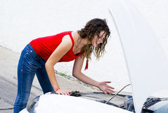 Car problems. Woman does not understand why her car engine failed Stock Photo