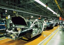 Car production line. With unfinished cars in a row Stock Photo