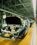 Car production line. With unfinished cars in a row Royalty Free Stock Photo