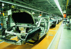 Car production line. Unfinished automobiles in a car plant Stock Image