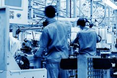Automobile production line. Car production line, skilled workers are working tense Royalty Free Stock Photos