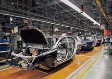 Car production line. With unfinished cars in a row Stock Images