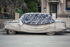 Car with protective cover Stock Image