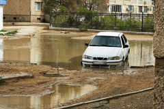 Car in a puddle. Stock Photography