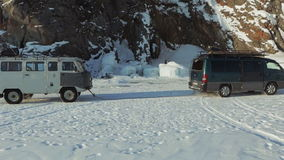 Car pulls a rope jammed in the ice machine. Beautiful winter Lake Baikal stock video