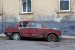 Car with punctured tires. On the street abandoned car with punctured tires stock photo