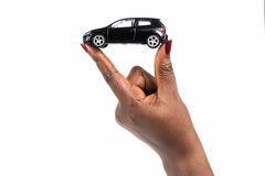 Car purchase. Hand holding dream car for car loan Royalty Free Stock Image