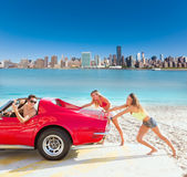 Car pushing teen girls humor funny guy driving. In Manhattan New York photo mount stock photos