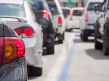 Car queue in the bad traffic road Royalty Free Stock Image