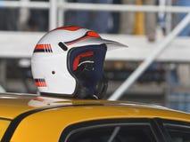 Car race abstract. A helmet of a driver on a race car Stock Image