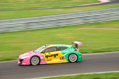 Car in a race with blurring in motion shot. The photo of racing car in motion shot with panning while renault world series took place at Moscow raceway track Royalty Free Stock Photography