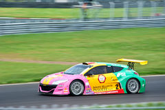 Car in a race with blurring in motion shot. The photo of racing car in motion shot with panning while renault world series took place at Moscow raceway track Royalty Free Stock Photos