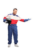 Car racer holding a helmet and gesturing Royalty Free Stock Photo