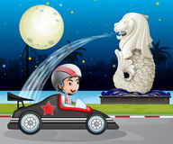 Car racer passing street with statue of Merlion Royalty Free Stock Image