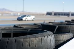 Car on Racetrack and Crash Tires Royalty Free Stock Image