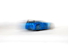 Car racing. A blue car racing isolated on white royalty free stock image
