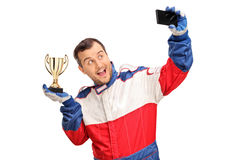 Car racing champion taking a selfie Royalty Free Stock Image