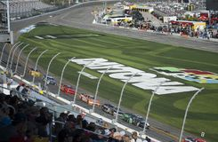 Car racing and fans close up. NASCAR, Daytona Speedway. View from the tribune on the racetrack in the time of the famous NASCAR car racing. Daytona International stock photos
