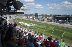 Car racing and fans. Competition at Daytona International speedway. View from the top of the tribune on the stadium in the time of NASCAR car racing. Daytona stock photo