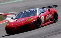 Car Racing(Ferrari F430 GT,Le Mans Series). Ferrari F430 GT,Le Mans Series race(LMS 1000km): in GERMANY, Circuit Nurburgring, August 23. 2009. LMGT2 Class Leo Royalty Free Stock Images