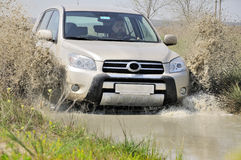 Car racing through mud Royalty Free Stock Image