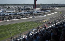 Car racing NASCAR, Daytona International Speedway. View from the tribune on the speedway in the time of the famous NASCAR car racing. Daytona International royalty free stock image