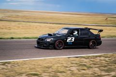 Car racing on track Royalty Free Stock Photography