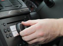 Car radio-adjusting volume Royalty Free Stock Photography