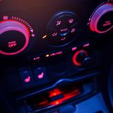 Button on dashboard in modern car panel. Car radio and air conditioner system. Button on dashboard in modern car panel. Navigation in car Royalty Free Stock Photo