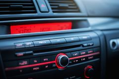 Car radio and air conditioner system. Button on dashboard in modern car panel. Navigation in car stock images