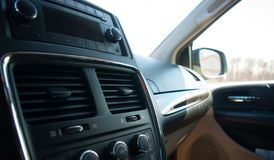 Black car interior with radio and glove compartment stock photos