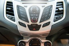 Car radio and phone system,Button on dashboard. In car panel royalty free stock photos