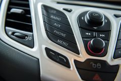 Car radio and phone system,Button on dashboard. In car panel stock photo