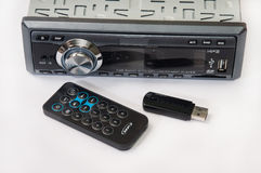 Car radio player with remote and usb flash Royalty Free Stock Photos