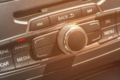 Car radio stereo panel and modern dashboard electric equipment. With burning sun Royalty Free Stock Photos