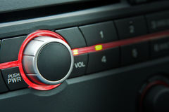 Car radio volume. A car radio volume knob with focus on the knob Stock Photos